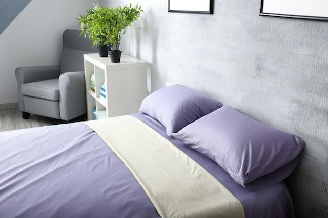 Cozy room interior with comfortable bed, closeup